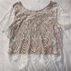 Lace blouse with nude lining.